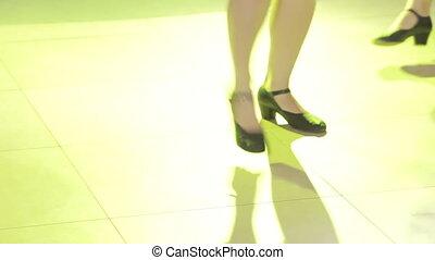 On stage, girls dance Ukrainian dances