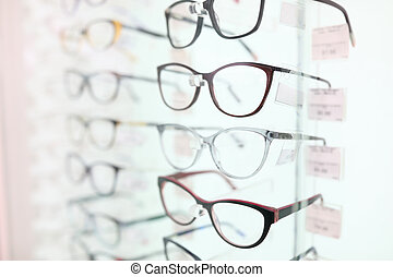 On stand are glasses in beautiful frames. closeup - On stand...