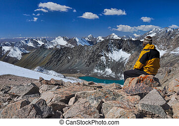 On summit in Kyrgyzstan - Young hiker on mountain summit in...