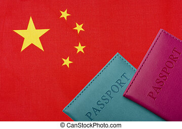 On the background of the Flag of China are a passport.