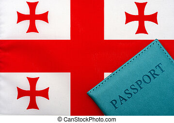 On the background of the flag of Georgia is a passport.