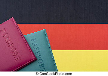 On the background of the flag of Germany two passports.