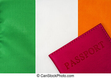 On the background of the flag of Ireland is a passport.