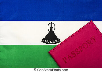 On the background of the flag of Lesotho is a passport.