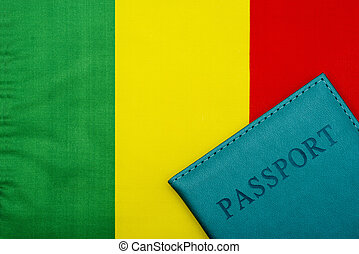 On the background of the flag of Mali is a passport.