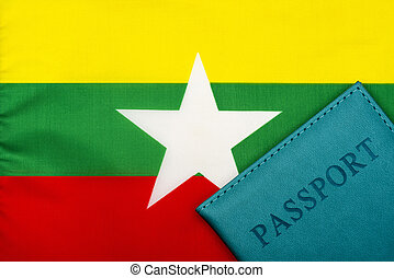 On the background of the flag of Myanmar is a passport.