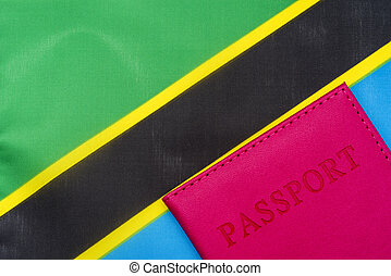 On the background of the flag of Tanzania is a passport.