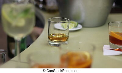 bartender gives whiskey for guest