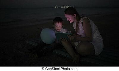 On the beach at night