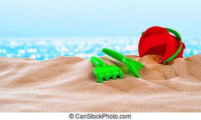 On the Beach / By the Sea - sand toys on a sand dune in...