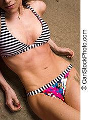 On the Beach - A beautiful Torso soaks up the Sun on the...