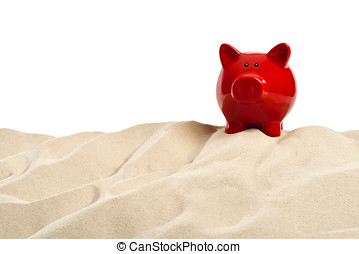 On the Beach - Sand dune with a red  piggy bank