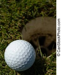 On the Edge - Golfball laying on the edge of a hole