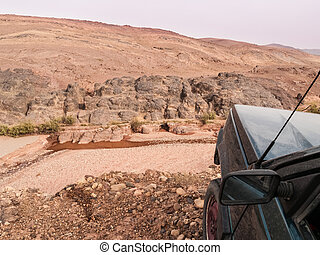 On the edge of the ravine - a dirty car on the edge of a...