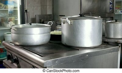 On the electric stove boil water in the saucepan for cooking