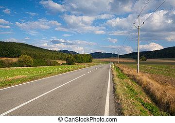 On the empty road between  field