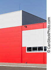 On the facade of a large industrial building made of aluminum panels