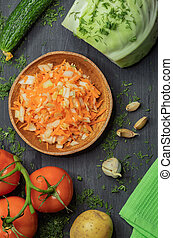 On the kitchen wooden table are ripe vegetables for cooking diet dishes