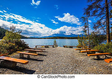 On the lake - wooden benches for rest