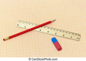 On the millimeter paper lie a ruler, a simple pencil and an eraser