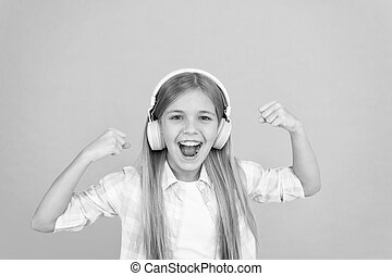 On the music waves. Adorable music fan. Music makes her happy. Little girl child listening to music. Happy little child enjoy music playing in headphones