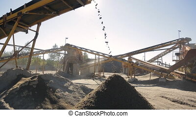 On the open area with conveyor belt falls into a pile of rubble