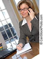 On the phone - cute blond on the phone in business clothes