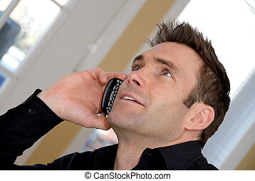 On the phone - cute man talking on the phone being happy