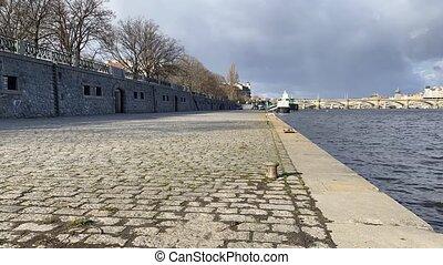 On the riverbank in Smichov, Prague, Czech Republic. ...