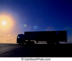On the road - Articulated lorry heading into the sunset....
