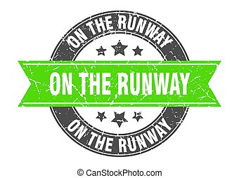on the runway round stamp with ribbon. label sign