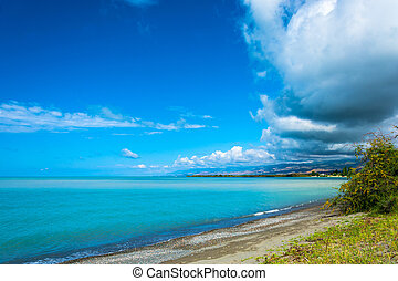 On the shore of Issyk-Kul lake in summer Sunny day, Kyrgyzstan.