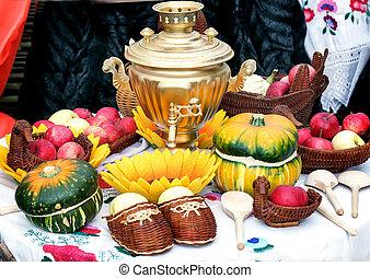 On the table for tea is a beautiful samovar .