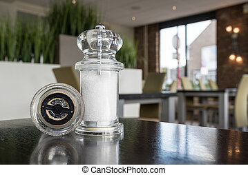pepper and salt mill - on the table in the restaurant there...