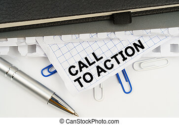 On the table is a pen, notebooks and a crumpled sheet of paper with the inscription - CALL TO ACTION