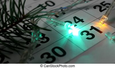 On the table is the New Year's December calendar and the New...