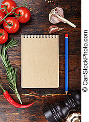 on the table vegetables and notepad