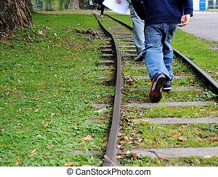 on the train tracks