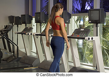 On The Treadmill - A woman walks on a treadmill