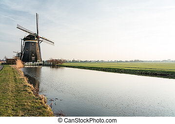 on the water there are several windmills in Stompwijk in Nederland