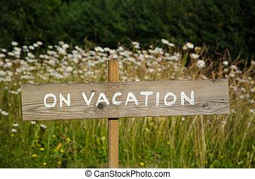 On Vacation wooden sign - On vacation wooden sign at a pole...