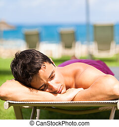young man sunbathing and relaxing