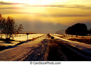 On winter road - Snow drifting crept sweeps on evening road
