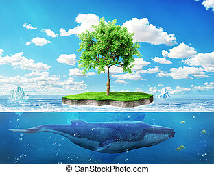 ?oncept of global warming. Island with a green tree in the...