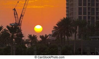 ondergaande zon , dichtbij, burj, khalifa, dubai, verenigde arabische emiraten, timelapse