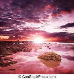 ondergaande zon , kust