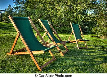 ondergaande zon , ligstoel