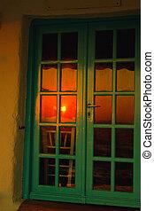 ondergaande zon , mykonos