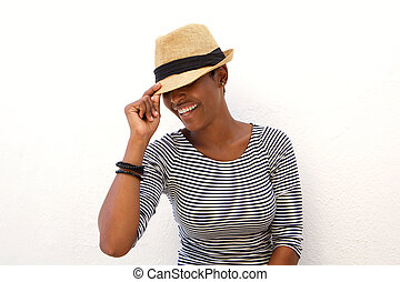 One african american woman smiling with hat