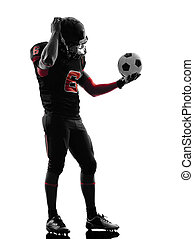 one american football player soccer ball confused in...